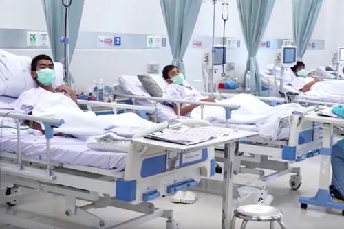 Thai soccer kids make victory signs from hospital beds