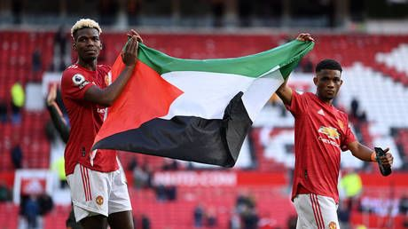 Man Utd star Pogba carries Palestinian flag around Old Trafford as World Cup winner is latest footballer to show support