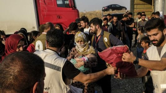 'We Didn't Believe We Would See The Sun Rise': Refugees From Syria Arrive In Iraq