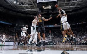 Behind Winston, No. 24 Michigan State tops No. 18 Iowa 78-70