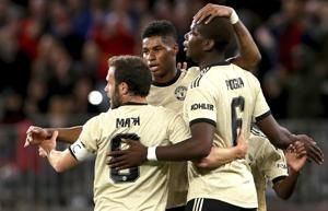 Martial penalty completes Man United's 4-0 win over Leeds