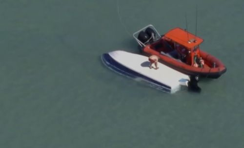 US Coast Guard searching for two missing boaters after a storm capsized their vessel