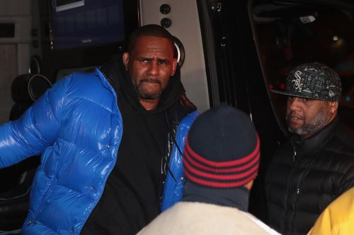 R. Kelly surrenders to police on sexual abuse charges