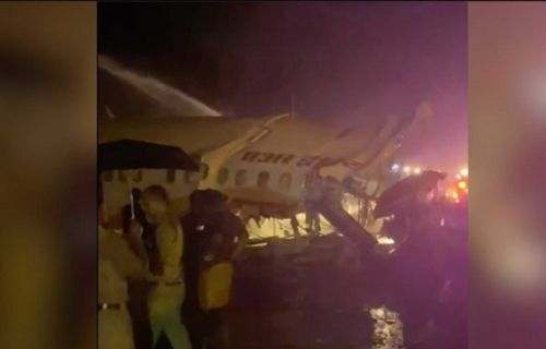 Several dead as Air Indian jet carrying 190 people breaks in two after skidding off runway into valley