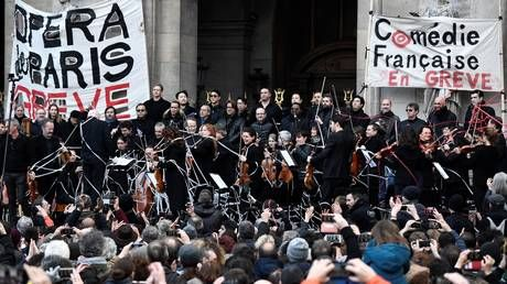 Striking Paris Opera artists perform outdoor concert against pension reforms - while Macron flees theater amid protests