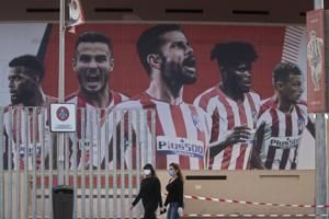 Atlético says 2 players infected but squad cleared to travel