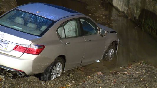 Vehicle becomes stuck near creek off of Streets Run Road