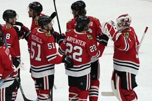 Kane helps Blackhawks beat Red Wings 4-1 for 1st win