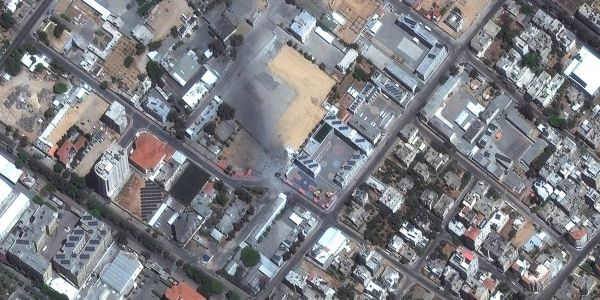 Satellite photos show leveled buildings and plumes of smoke in Gaza after Israel's airstrikes
