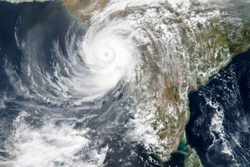 Deadly cyclone strikes India; Navy scours sea after barge sinks, 2nd set adrift