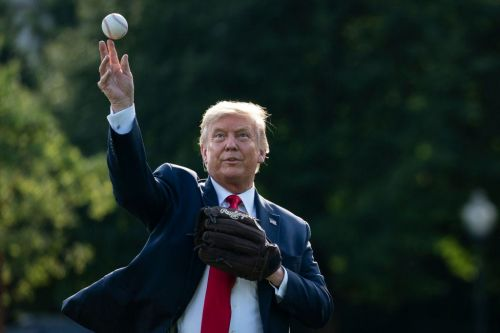Trump ridicules Fauci for throwing 'the worst first pitch' in baseball history and urges him to stop wearing a Washington Nationals face mask