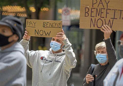 Advocates, elected officials, unemployed workers rally to demand changes to the system