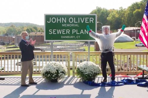John Oliver visits Connecticut sewer plant named after him in homemade suit