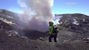 Climbers summit the crater of the Mt. Etna in Europe