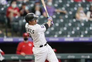 Fuentes, Gonzalez shine as Rockies hold off Reds 13-8