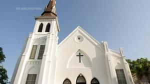 Families of 9 killed in SC church settle with feds