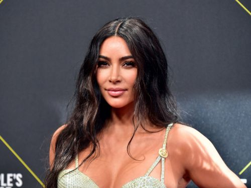 Kim Kardashian went minimal with all-white Christmas decor, filling her home with fuzzy trees