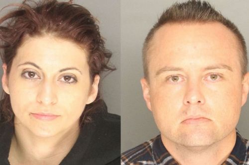 Couple charged after dismembered body pulled from golf course lake