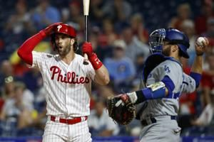 Dodgers throw 2-hitter, beat Phillies after long rain delay