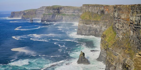A college student fell to his death at the Cliffs of Moher while taking selfies, a coroner said
