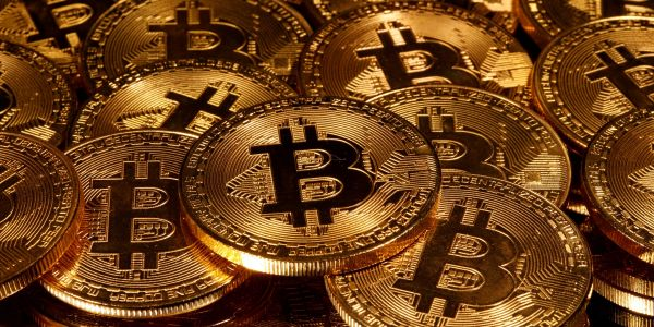 Young investors are flooding into bitcoin in the pandemic, while the older generation can't get enough of gold, a team of JPMorgan analysts said