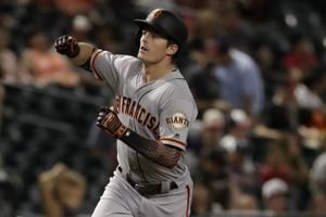 Yastrzemski hits 3 HRs, Giants beat D'backs in 11 innings
