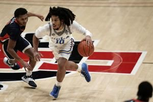 Smith, No. 22 Bruins need 3 OTs to beat Pepperdine 107-98