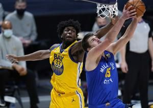 Jokic, Nuggets hold off Curry, Warriors for 114-104 win