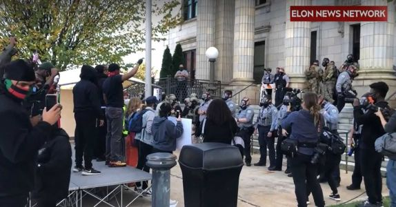 Authorities pepper spray, arrest people in North Carolina after traffic blocked during voter rally
