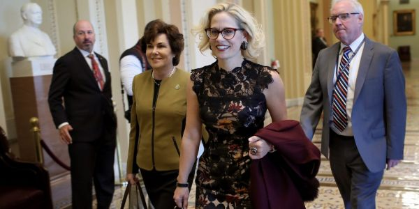 Democratic Sen. Kyrsten Sinema votes against $15 minimum wage with a dramatic thumbs down