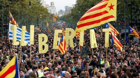 'Hundreds of thousands' join pro-independence rally in Barcelona as Catalonia goes on a 24-hour general strike