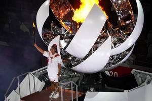 Naomi Osaka lights Tokyo Games cauldron with Olympic flame. See scenes from the opening ceremony