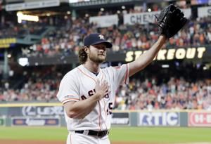 Cole reaches 300 Ks for season, Astros beat Rangers 3-2