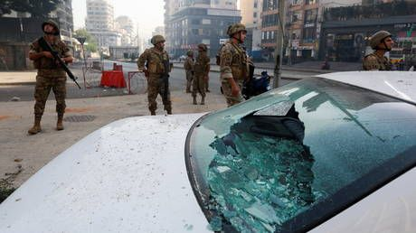 Dozens charged in Lebanon over deadly Beirut clashes amid protests against port blast judge
