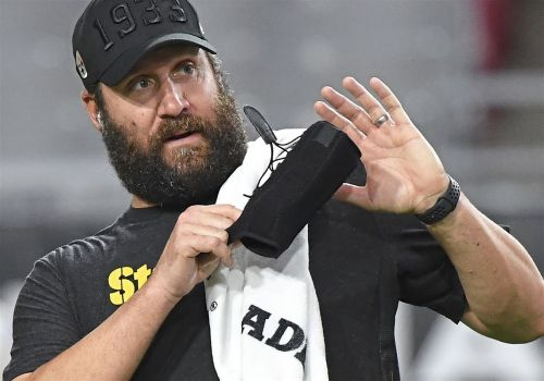 Ben Roethlisberger throws a football; Steelers optimistic on recovery