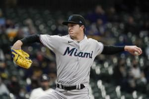 Dickerson leads way as Marlins beat Burnes, Brewers 8-0