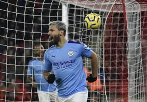 Aguero grabs winner for Man City as Laporte makes return