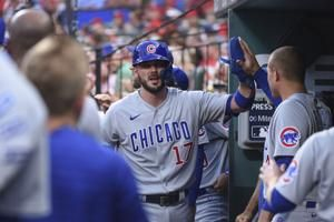 Chicago Cubs rally with 6 runs in the 9th inning for a wild 7-6 win over the St. Louis Cardinals