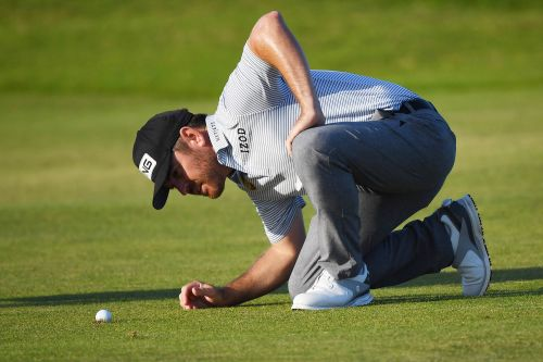 Louis Oosthuizen holds on to slim lead in quest for British Open history