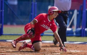 Japan tops Australia in softball as delayed Tokyo Games open