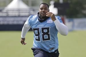 Titans activate top pick Simmons after torn ACL in February