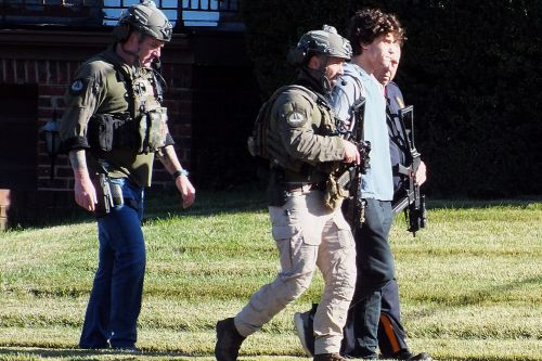 Grandson of man found with fatal ax wound arrested after standoff