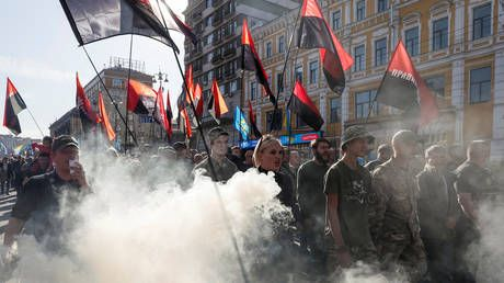 'No to capitulation! Death to our enemies!' Nationalists march in Kiev against roadmap to peace in Ukraine