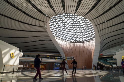 What it's like to travel through Beijing's futuristic new airport, which is shaped like a starfish and is the biggest single terminal in the world