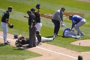 Abreu, Dozier collide, Royals snap 11-game skid, beat Chisox
