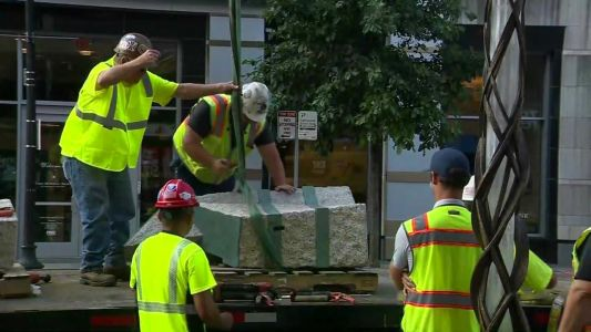Final stones added to Boston Marathon bombing memorial