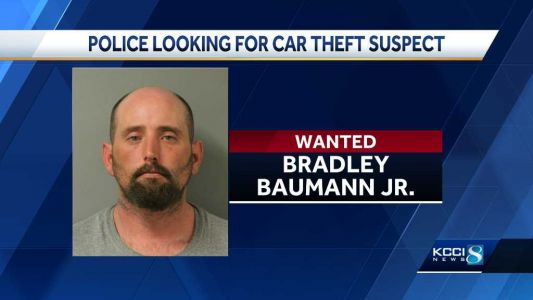 Police search for 'armed and dangerous' car theft suspect