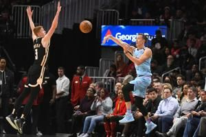 Young's career-high 50 points lead Hawks past Heat, 129-124