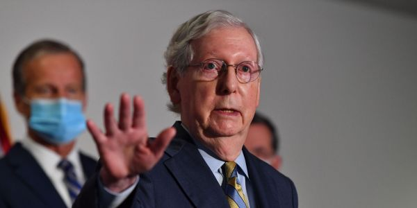 Mitch McConnell poured cold water on the $908 billion COVID-19 stimulus plan, arguing that Trump would veto it