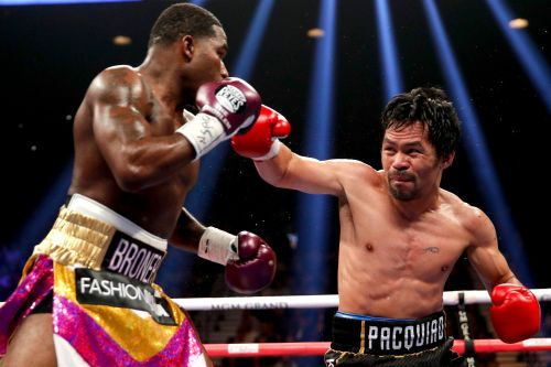 Manny Pacquiao victorious at age 40 as Mayweather looks on